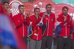 Gruppo croato di tennis sulla celebrazione domestica benvenuta immagine stock