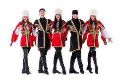 Gruppo del ballerino costumi caucasici pieghi d'uso di un abitante degli altipiani scozzesi Immagine Stock Libera da Diritti