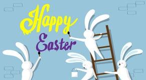Gruppo del coniglio che sta sull'insegna felice di festa della parete di Pasqua della pittura della spazzola della tenuta della s Fotografie Stock