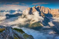 Gruppo Del Cristallo mountain range at foggy summer morning. Dol Stock Photos