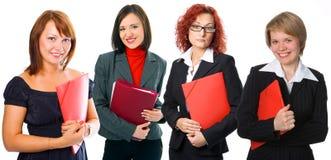 Gruppo della donna della gente con i dispositivi di piegatura Immagini Stock Libere da Diritti