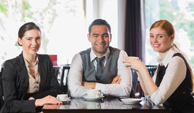 Gruppo di affari che mangia caffè insieme Fotografia Stock