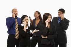 Gruppo di affari con i telefoni Immagini Stock