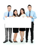Gruppo di affari con la grande scheda in bianco Fotografia Stock Libera da Diritti