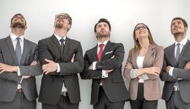 Gruppo di affari positivo felice che cerca con il sogno dell'espressione fotografie stock