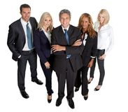 Gruppo di affari vario che si leva in piedi fiero sul bianco Immagine Stock