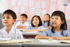 Gruppo di allievi in un banco cinese Fotografia Stock Libera da Diritti