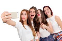 Gruppo di amiche che prendono selfie Fotografie Stock