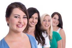 Gruppo di apprendisti felici nei primi lavori isolati sul backgrou bianco Fotografia Stock