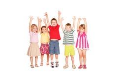 Gruppo di bambini che sollevano le loro mani su Fotografia Stock Libera da Diritti