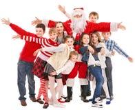 Gruppo di bambini con il Babbo Natale. fotografia stock