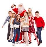 Gruppo di bambini con il Babbo Natale. Fotografia Stock Libera da Diritti