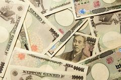 Gruppo di banconota giapponese un fondo da 10000 Yen Immagini Stock