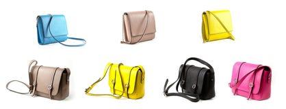 Gruppo di borsa di cuoio delle donne isolata su fondo bianco Immagine Stock