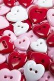 Gruppo di bottoni a forma di del cuore Fotografia Stock