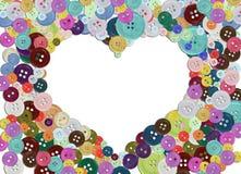 Gruppo di bottoni variopinti che formano un cuore Fotografie Stock Libere da Diritti