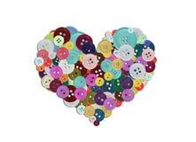 Gruppo di bottoni variopinti che formano un cuore Immagine Stock Libera da Diritti