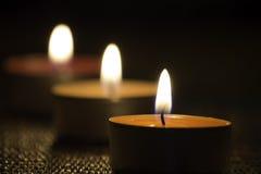 Gruppo di candele burning Fotografie Stock Libere da Diritti