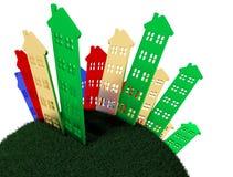 Gruppo di case che stanno sulla terra rotonda Immagini Stock Libere da Diritti