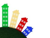 Gruppo di case che stanno sulla terra rotonda Immagine Stock