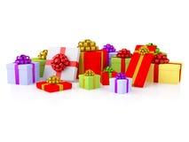 Gruppo di contenitori di regalo variopinti con gli archi festivi Immagine Stock Libera da Diritti