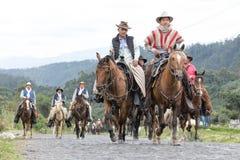 Gruppo di cowboy a cavallo Fotografia Stock