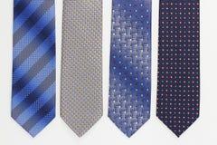 Gruppo di cravatte variopinte su bianco Immagini Stock Libere da Diritti