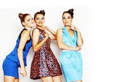 Gruppo di diverse signore alla moda in vestiti luminosi isolati su wh Fotografia Stock