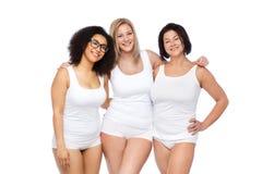 Gruppo di felice più le donne di dimensione in biancheria intima bianca Immagine Stock Libera da Diritti