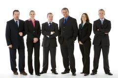 Gruppo di gente di affari che si leva in piedi in una riga Fotografie Stock