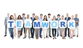 Gruppo di gente di affari che tiene lavoro di squadra di parola Fotografia Stock