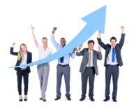 Gruppo di gente di affari sul miglioramento della situazione economica Immagini Stock Libere da Diritti