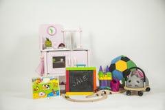 Gruppo di giocattoli in un fondo bianco Immagini Stock