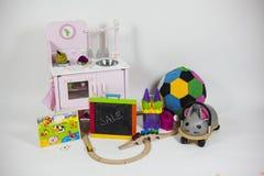 Gruppo di giocattoli in un fondo bianco Fotografia Stock