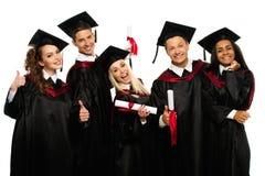 Gruppo di giovani studenti graduati Immagini Stock