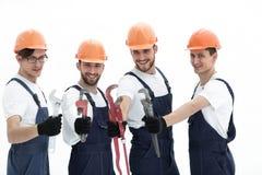 Gruppo di idraulici con gli attrezzi Fotografie Stock