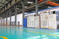 Gruppo di lavoro di produzione manifatturiera in una fabbrica Fotografia Stock