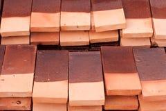 Gruppo di mattoni rossi sul cantiere Fotografie Stock