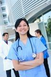 Gruppo di medici della donna e dell'uomo Immagine Stock