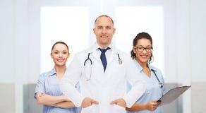 Gruppo di medici felici all'ospedale Fotografia Stock