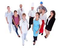 Gruppo di persone che rappresentano le diverse professioni Immagine Stock Libera da Diritti