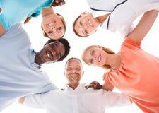 Gruppo di persone con la testa insieme Fotografia Stock