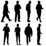 Gruppo di persone della siluetta nero che stanno in varie pose royalty illustrazione gratis