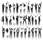Gruppo di persone della siluetta stare e la celebrazione Fotografie Stock