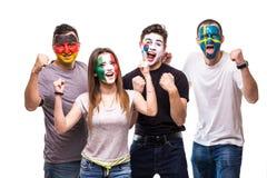 Gruppo di persone i fan dei sostenitori delle squadre nazionali con il fronte dipinto della bandiera Repubblica della Germania, M Fotografie Stock Libere da Diritti