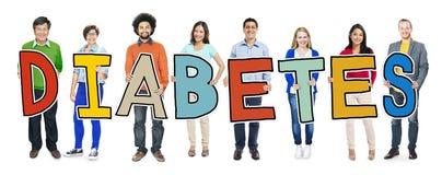 Gruppo di persone Multi-etnico che tengono il diabete del testo fotografia stock libera da diritti