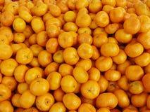 Gruppo di piccole arance cinesi, Immagini Stock