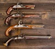Gruppo di pistole reali del Flintlock Immagini Stock