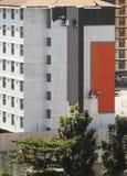 gruppo di pittura del lavoratore sulla nuova costruzione fotografia stock libera da diritti