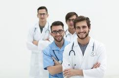 Gruppo di riusciti medici Isolato su bianco Immagini Stock